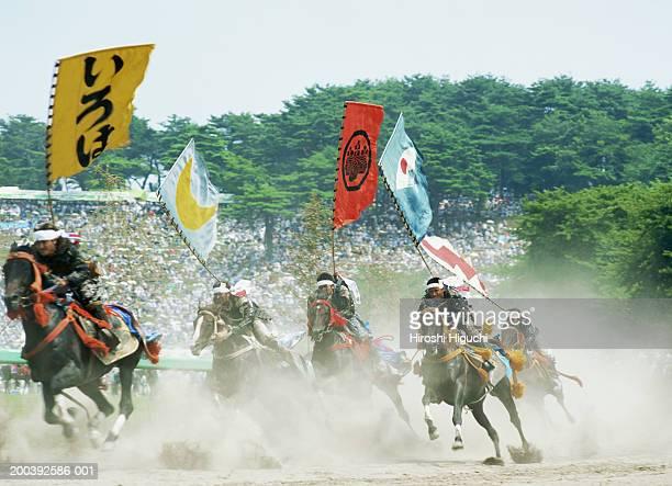 japan, the soma nomaoi festival, samurai carrying flags racing horses - soma nomaoi festival ストックフォトと画像