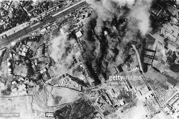 Japan - This file photo shows Tokyo scorched and smoldering from air raids. The photo was taken in 1945, with its specific date unknown.