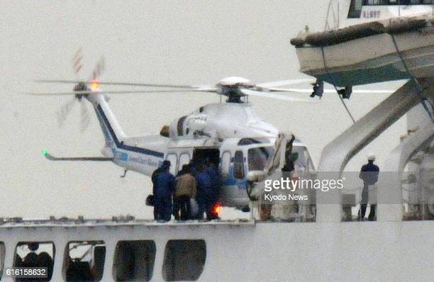 SAKAIMINATO Japan Three North Korean men and others board a helicopter on a Japan Coast Guard vessel anchored off Sakaiminato Tottori Prefecture on...