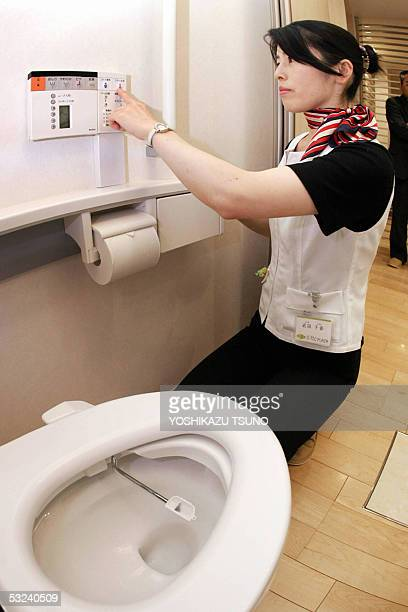 TO GO WITH 'LIFESTYLEHEALTHJAPANTOILET' Chiharu Takeda employee of Japan's home builder Daiwa House shows how to use a device of urine protein tester...