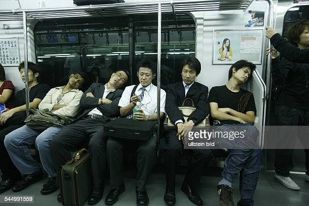 sleeping passengers in a train of the Yamanote line
