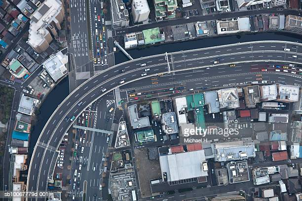 japan, tokyo, aerial view of traffic and street at minato-ku ward - overhead view of traffic on city street tokyo japan stock photos and pictures