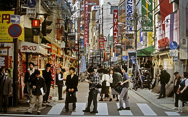 Japan, Tokyo, Asakusa District, people walking on street