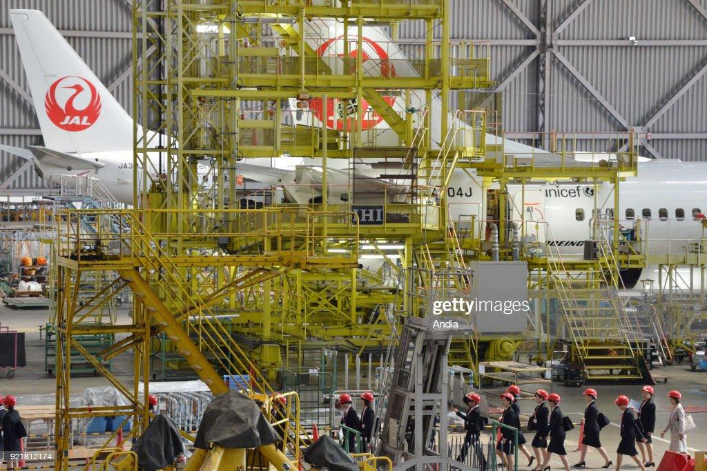 Boeing 737 in a Japan Airlines maintenance hangar (JAL) at Haneda Airport ().