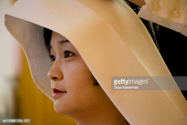 Japan, Tokyo, bride wearing traditional headwear, side view, close up