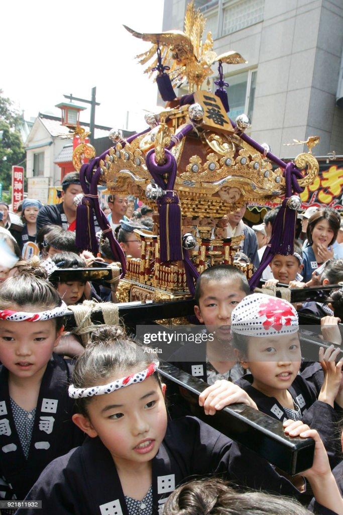 child carrying a mikoshi (divine palanquin) during a Kanda matsuri, Shinto festival, on .