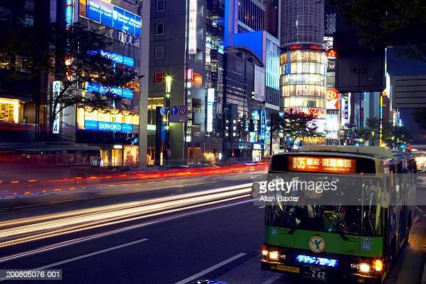 Japan, Tokyo, Chuo Ward, Ginza, shops and bus at night