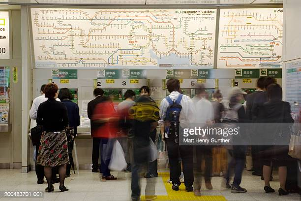 Japan, Tokyo, commuters in station buying tickets (long exposure)