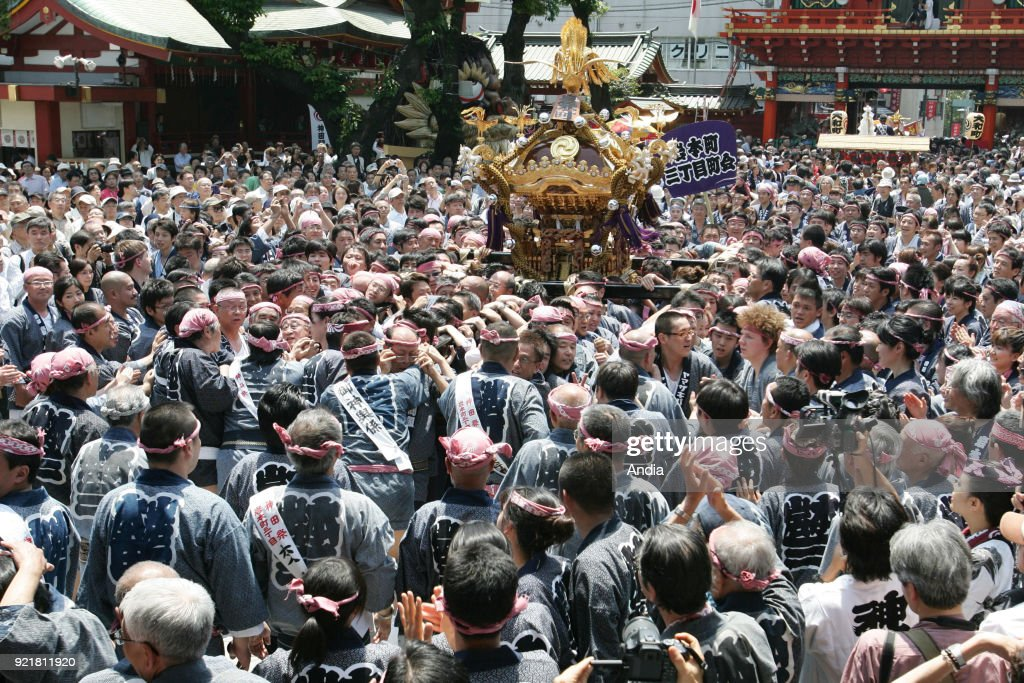 crowd and people carrying a mikoshi (divine palanquin) during a Kanda matsuri, Shinto festival, on .
