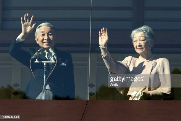 Emperor Akihito and Empress Michiko greeting the crowd who came for the 77th birthday of Emperor Akihito