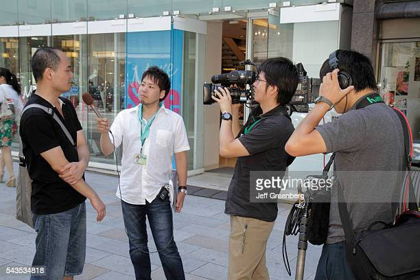 Japan Tokyo Ginza Chuo Dori Street TV television media video camcorder crew reporter microphone interview man