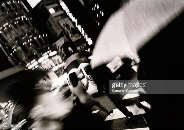 Japan, Tokyo, Ginza, pedestrian crossing in rain (B&W)