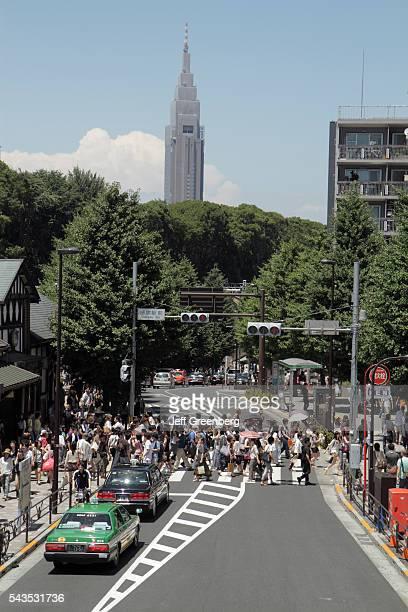 Japan Tokyo Harajuku JR Harajuku Station crowd group crossing street pedestrians traffic signal skyscraper NTT DoCoMo Yoyogi Bui