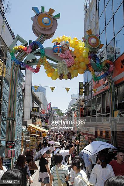 Japan Tokyo Harajuku Takeshita Dori Street entrance shopping shoppers balloons arch