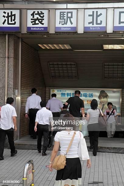 Japan Tokyo Ikebukuro JR Ikebukuro Station north entrance exit Asian man men woman women commuters entering kanji hiragana character