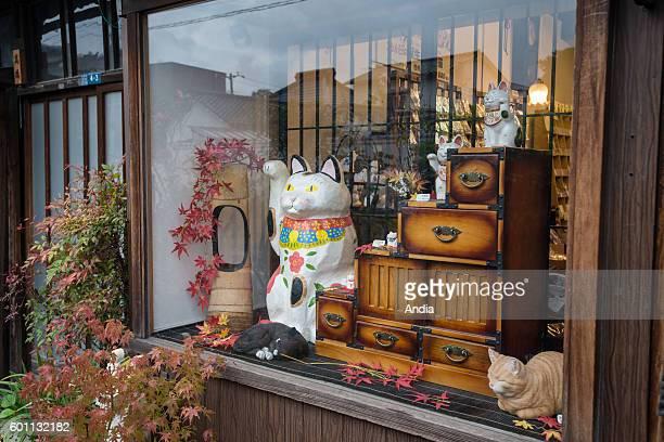 manekineko in a shop window of the district of Yanaka