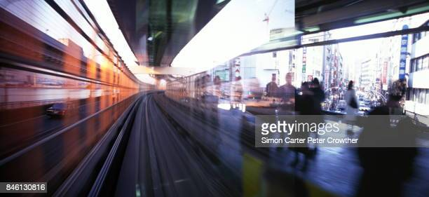 Japan, Tokyo, monorail and commuters.