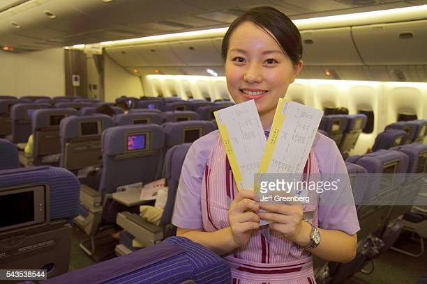Japan Tokyo Narita International Airport NRT gate area concourse ANA Al Nippon Airways cabin onboard flight to Shanghai Asian woman custom forms