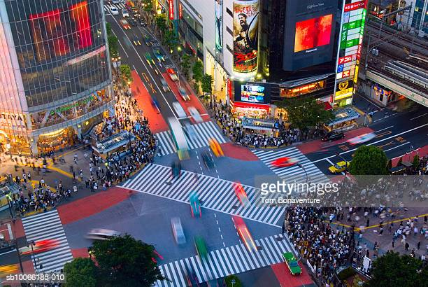 Japan, Tokyo, pedestrians on Shibuya crossing in evening, elevated view