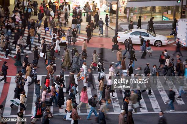 japan, tokyo, shibuya, commuters, elevated view (blurred motion) - busy sidewalk stock pictures, royalty-free photos & images