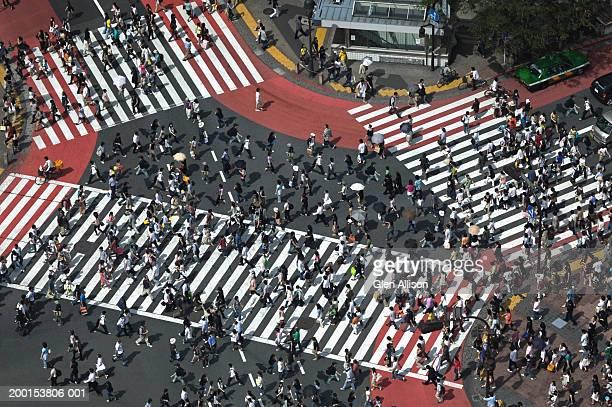 Japan, Tokyo, Shibuya, pedestrians crossing street, elevated view
