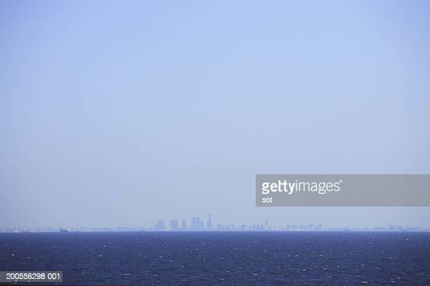 Japan, Tokyo skyline in distance over ocean