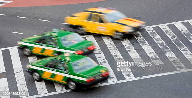 Japan, Tokyo, taxis, elevated view (blurred motion)