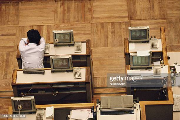 Japan, Tokyo, Tokyo Stock Exchange, man resting on desk