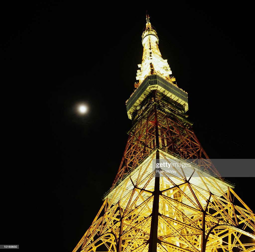 Japan, Tokyo Tower at night with moon shining above, view from below : Stock Photo