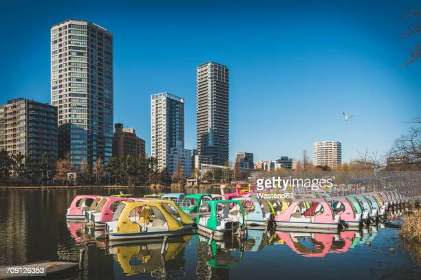 japan, tokyo, ueno, colorful paddleboats in ueno park - ueno park stock photos and pictures