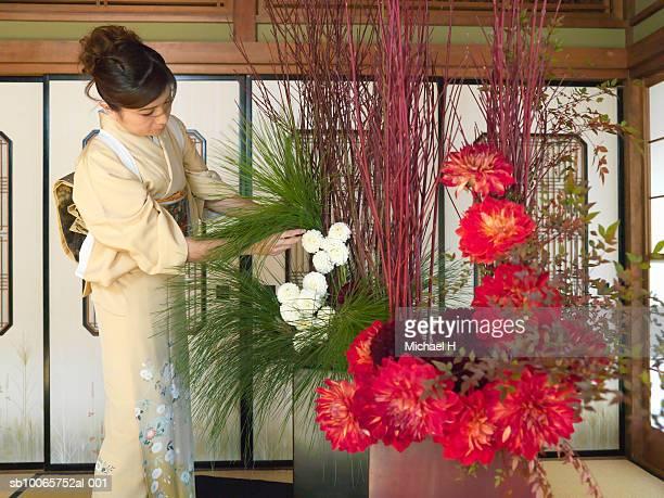 Japan, Tokyo, woman taking care of flower arrangement