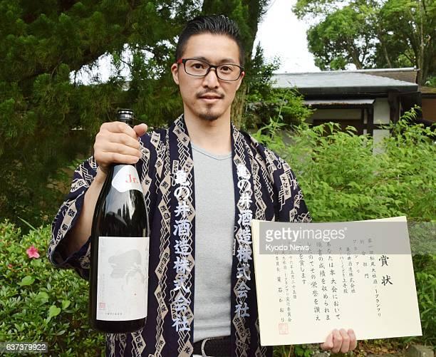 KYOTO Japan Toshinori Imai of Kamenoi Shuzo a brewer from Tsuruoka Yamagata Prefecture holds 'Kudoki Jozu Jr White' which won the first place in the...