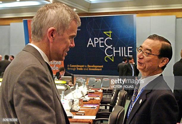 Japan Trade representative Ryuichiro Yamazaki talks to James Sutton New Zealand Trade Negotiations Minister during the last session of the...
