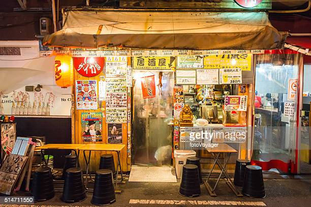 Japan traditional back street bar restaurant illuminated at night Osaka