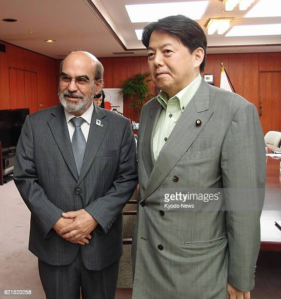TOKYO Japan UN Food and Agriculture Organization chief Jose Graziano da Silva and Japanese farm minister Yoshimasa Hayashi head to their meeting at...