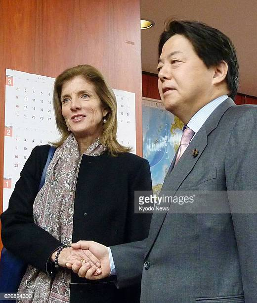 TOKYO Japan US Ambassador to Japan Caroline Kennedy and Japanese farm minister Yoshimasa Hayashi shake hands before their talks at the ministry in...