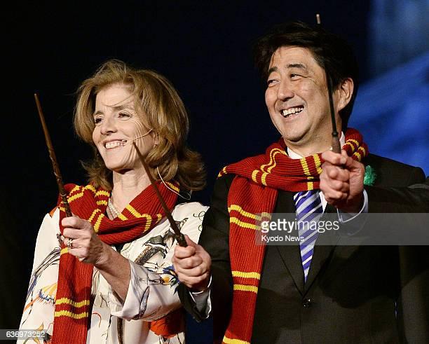 OSAKA Japan US Ambassador to Japan Caroline Kennedy and Japanese Prime Minister Shinzo Abe smile during a press event at Universal Studios Japan in...