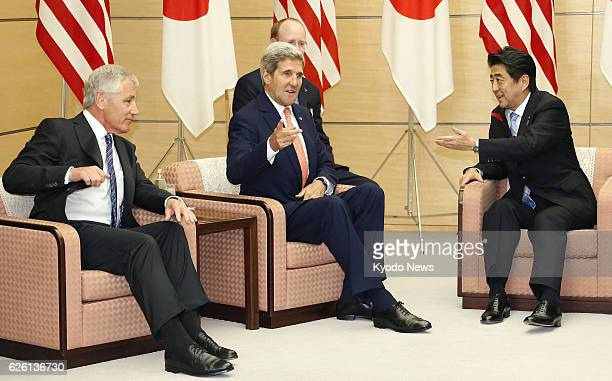 TOKYO Japan US Defense Secretary Chuck Hagel US Secretary of State John Kerry and Japanese Prime Minister Shinzo Abe hold talks at the prime...