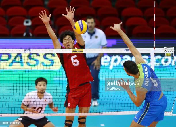 Japan v Slovenia FIVP Men's World Championship Tatsuya Fukuzawa of Japan blocks on Mitja Gasparini of Slovenia at Mandela Forum in Florence Italy on...