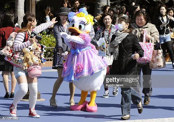 URAYASU Japan Visitors enter Tokyo DisneySea Park in Urayasu Chiba Prefecture on April 28 as the park reopened the same day ahead of the Golden Week...
