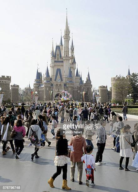 URAYASU Japan Visitors flock to Tokyo Disneyland as the theme park in Urayasu Chiba Prefecture east of Tokyo reopened on April 15 after suspending...