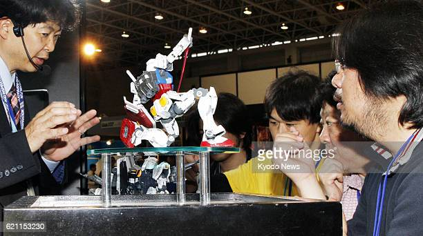 SHIZUOKA Japan Visitors view new plastic models from the Mobile Suit Gundam robot animation series at the Shizuoka Hobby Show 2013 a major toy...