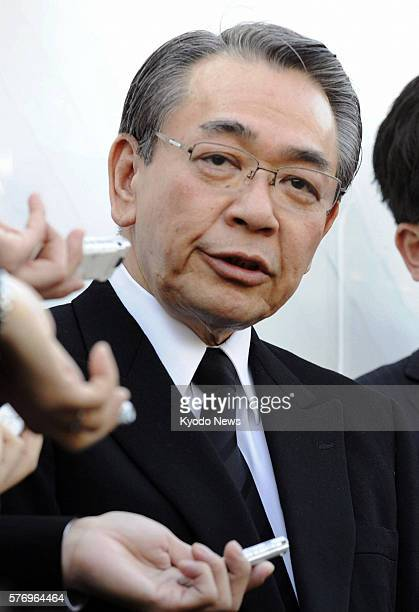 AMAGASAKI Japan West Japan Railway Co President Takayuki Sasaki speaks to reporters after offering flowers at the fatal train accident site in...