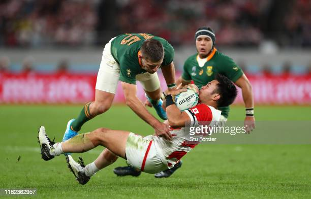 Japan wing Kenki Fukuoka is tackled by Willie Le Roux as Cheslin Kolbe looks on during the Rugby World Cup 2019 Quarter Final match between Japan and...