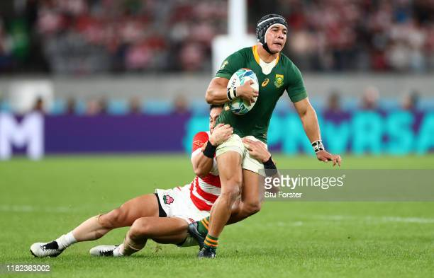 Japan wing Kenki Fukuoka puts in a tackle on South Africa wing Cheslin Kolbe during the Rugby World Cup 2019 Quarter Final match between Japan and...