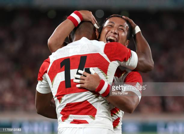 Japan wing Kotaro Matsushima is congratulated after scoring the opening try by Yutaka Nagare during the Rugby World Cup 2019 Group A game between...
