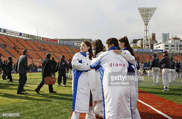 YOKOHAMA Japan Women at Yokohama Stadium in Kanagawa Prefecture evacuate to the field on March 11 after a powerful earthquake hit northeastern Japan...