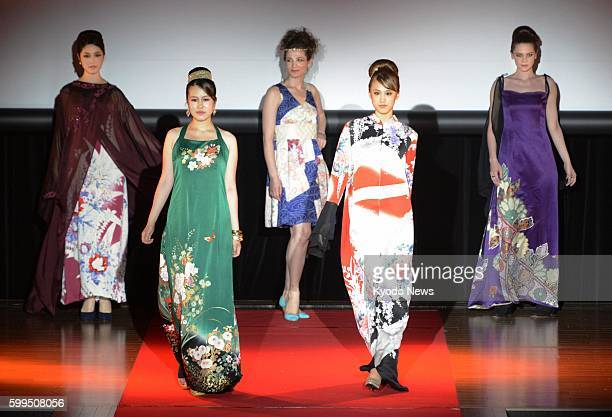 TOKYO Japan Women in 'abaya' made from kimono fabric pose during a fashion show featuring the traditional attire for Arab women in Tokyo on July 15...