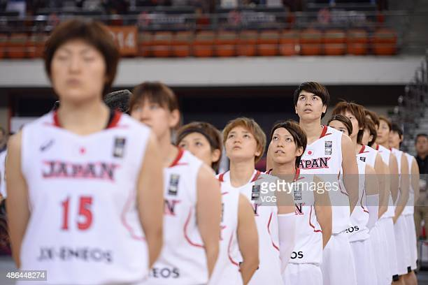 Japan women team attend flagraising ceremony ahead of semifinal match between Japan and Chinese Taipei during the 2015 FIBA Asia Championship for...