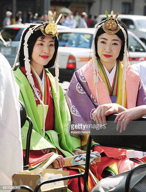 """Japan - Women wear """"junihitoe"""" , a type of court attire, as participants in a parade held in Kyoto, western Japan, on April 27 to commemorate the..."""